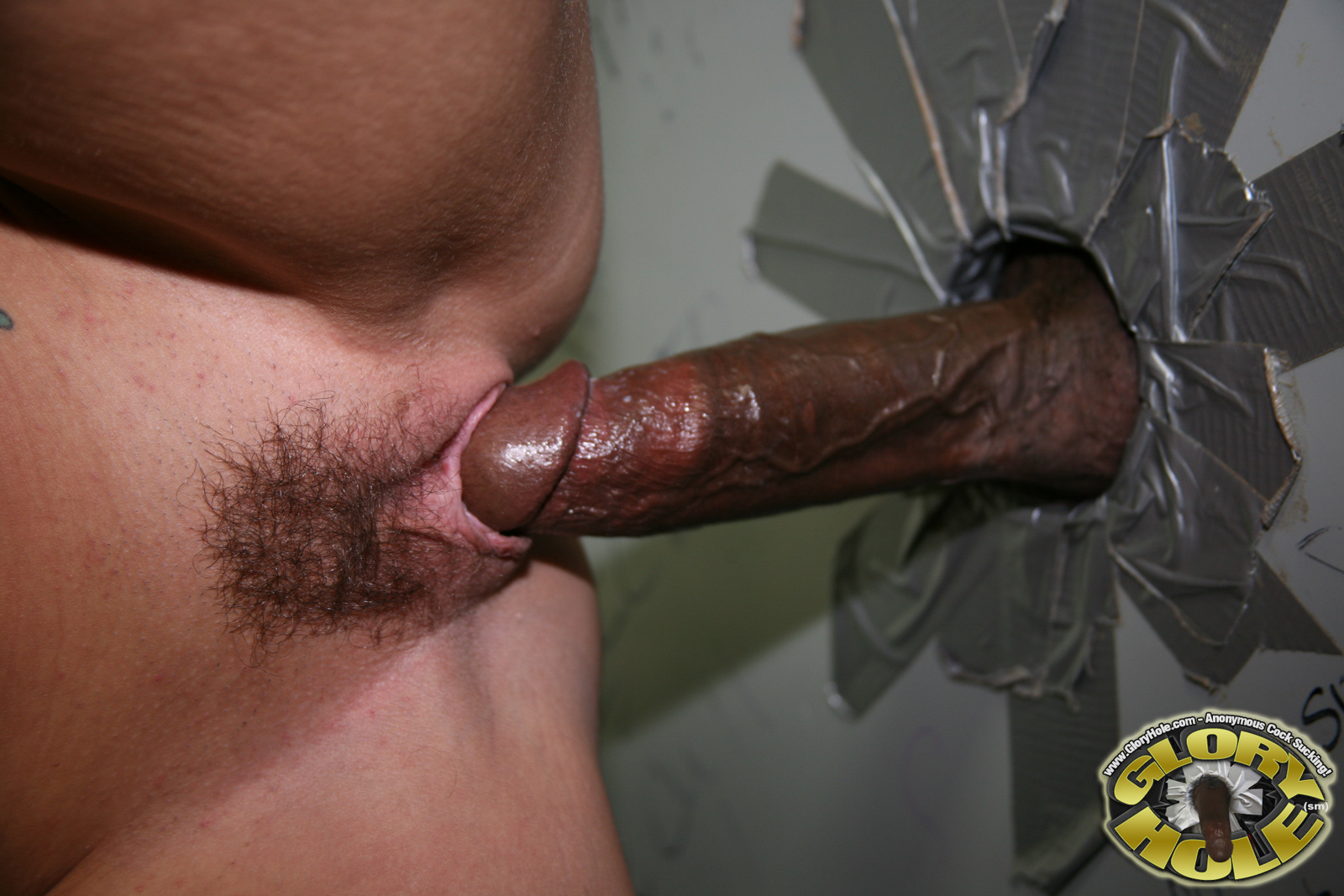 sucking woman cock glory hole